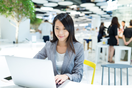 Businesswoman working on notebook computer at co work space