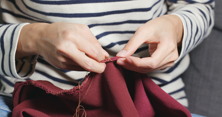 Hand Sews with a needle and thread at home
