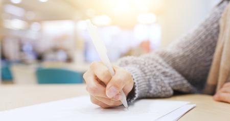 Photo pour Student study in the library - image libre de droit