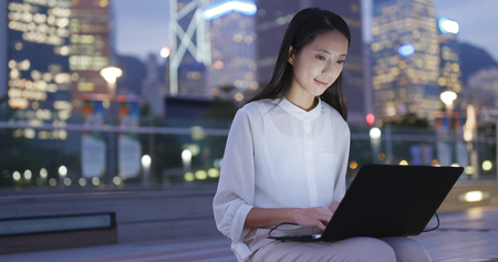 Foto de Business woman work on laptop computer at outdoor - Imagen libre de derechos