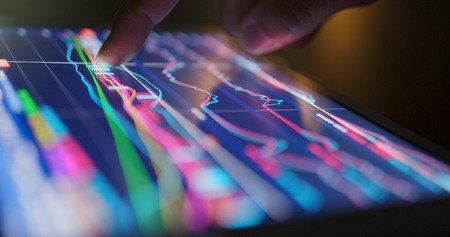 Photo pour Stock market data on tablet - image libre de droit