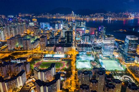 Photo pour Kowloon Bay, Hong Kong 25 April 2019: Top view of city of Hong Kong at night - image libre de droit