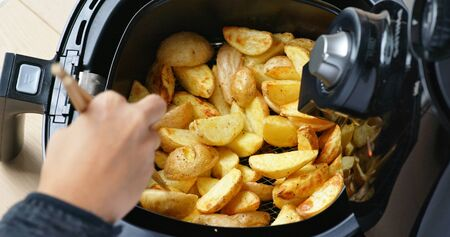 Photo for Air fryer homemade grilled potato - Royalty Free Image