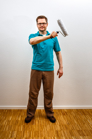 Man paints on imaginary concept wall, vertical format