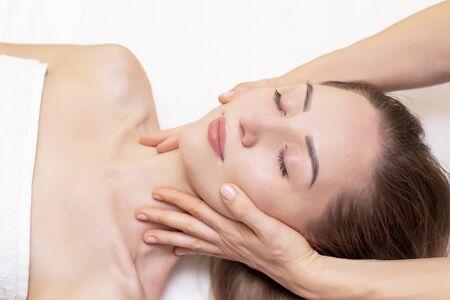 Photo pour Massage and body care. Spa body massage woman hands treatment. Woman having massage in the spa salon for beautiful girl - image libre de droit