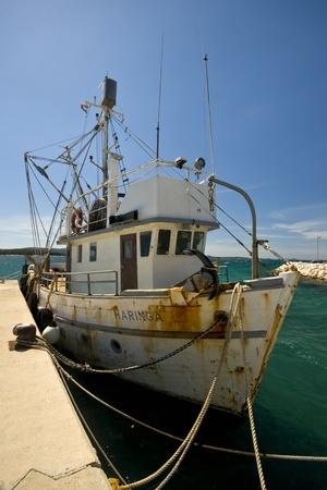 Rusty fishing boat berthed on a pier of Biograd na moru