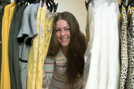Woman choosing clothes from her robe