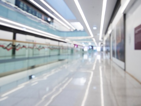 Interior of the modern building, blurred shopping mall background. Commercial or business center.