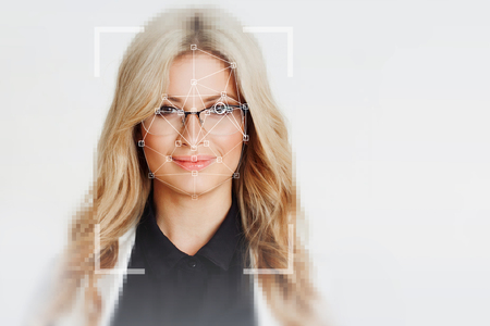 The technology of facial recognition. Portrait of beautiful blonde