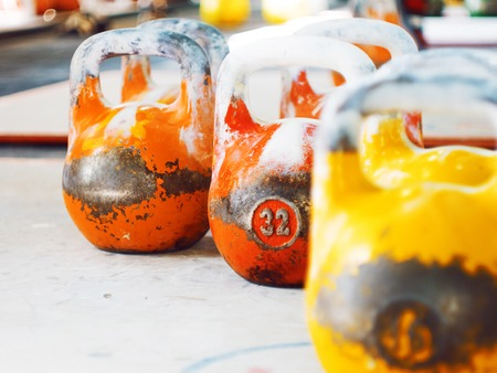 Multicolor kettlebells on gym. Close up. Work out with kettlebells