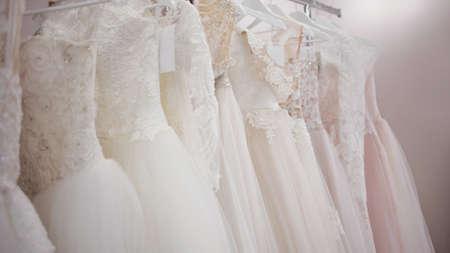 Photo pour Shop for wedding and evening dresses. Beautiful lush wedding dresses for brides. Wedding salon, a wide range - image libre de droit