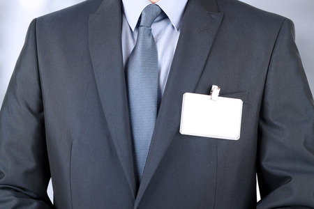 The business man in a modern suit with  a  Blank Badge