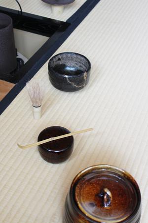 Repair of crack pottery tea cup and tea utensils  / vertical