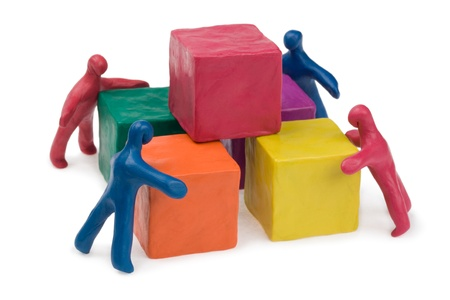 Business teamwork - collective problem solving. Plasticine. Isolated.