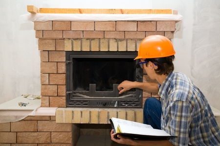 Building  inspector examines a new fireplace