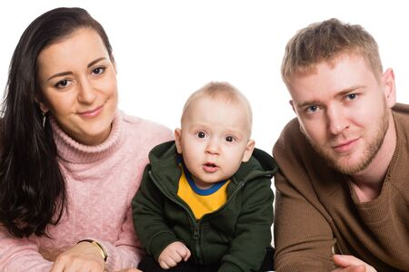 Photo pour Portrait young family father mother and little boy. Isolated on white. - image libre de droit