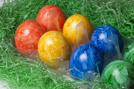 Plastic box with colored Easter eggs