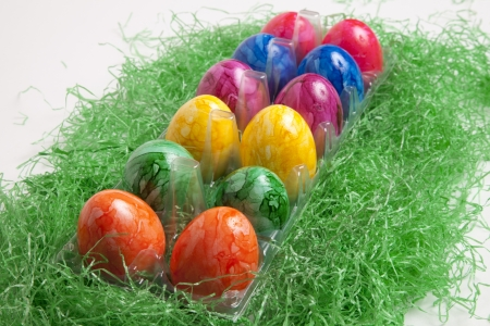 Colored Easter eggs in plastic box