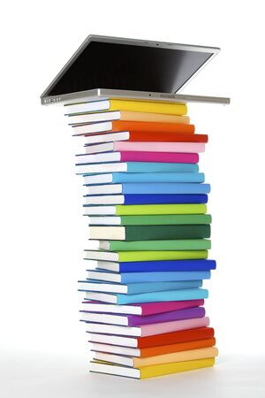 Photo pour E-learning concept: laptop on top of stack of colourful real books on white background, side view. - image libre de droit