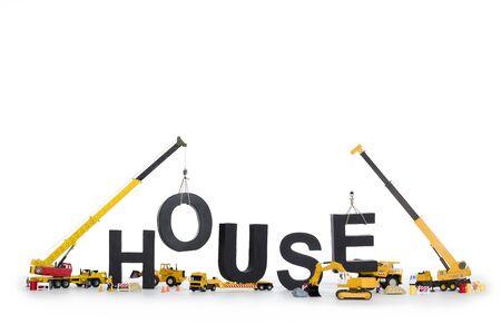 Photo pour House under construction: Machines building house-word. - image libre de droit