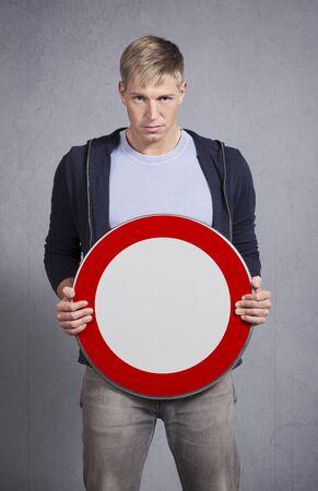 Man showing universal forbidden sign.