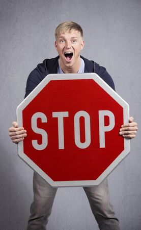 Alert man showing stop sign.