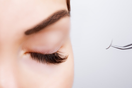 Photo pour Woman Eye with Long Eyelashes. Eyelash Extension. Lashes. Close up, selected focus - image libre de droit