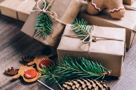 Foto de Christmas Gifts with Boxes on Wooden Background. Vintage Style. Closeup, selective focus. - Imagen libre de derechos