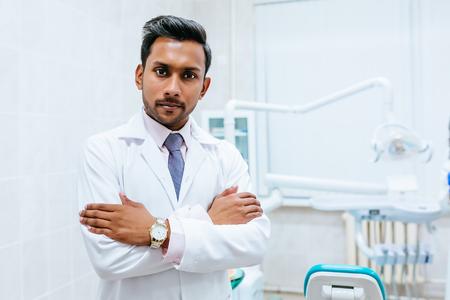 Photo pour Portrait of a young confident asian male dentist in clinic. Dental clinic concept - image libre de droit