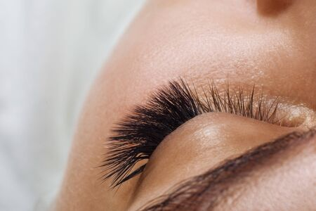 Photo for Eyelash Extension Procedure. Woman Eye with Long Blue Eyelashes. Ombre effect. Close up, selective focus. - Royalty Free Image