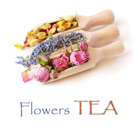 Flowers tea collection in a wooden scoops on a white background
