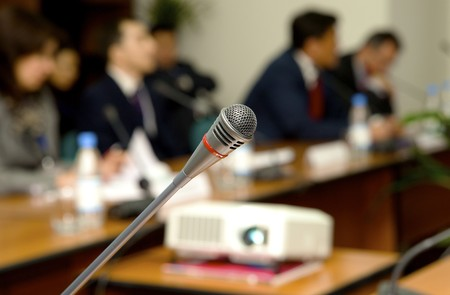 Microphone for the speaker in a conference to a hall