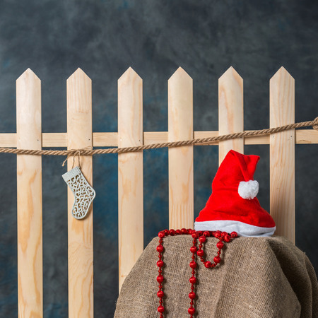 Santa hats hanging on a wooden fence. Decorations for the New Year.