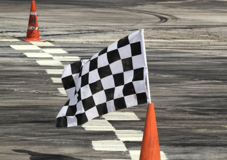 Finish flag on track in racing car