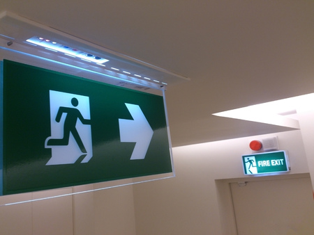 Emergency exit sign in building (fire exit)