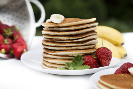 Homemade pancakes with fresh strawberries and honey. Pancakes for Breakfast.Gluten-free: Pancake with rice milk and rice flou