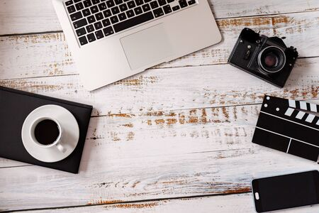 Photo for Flat lay on wooden background with black vintage camera and laptop - Royalty Free Image