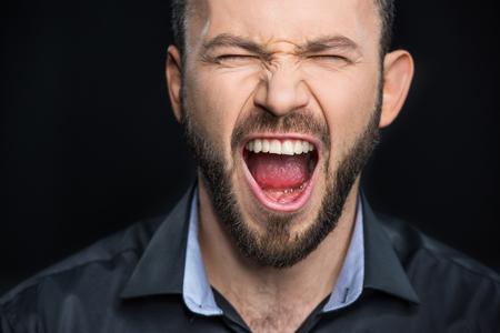 Bearded man screaming