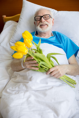 senior patient with tulip flowers