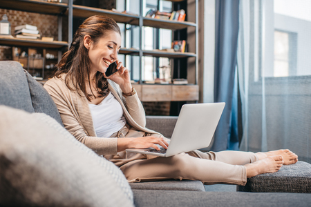 Photo for Businesswoman remote working and using digital devices - Royalty Free Image