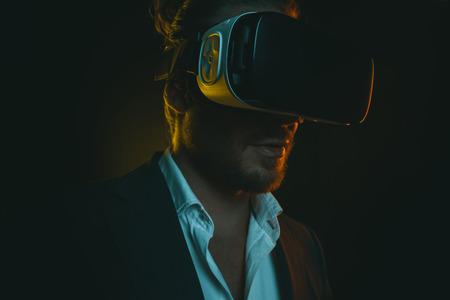 young stylish man using virtual reality headset