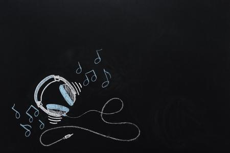 Photo pour headphones with wire and musical notes drawn - image libre de droit