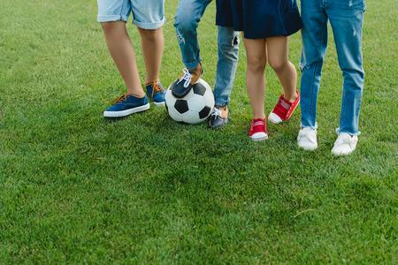 Foto de children standing with soccer ball on green grass - Imagen libre de derechos