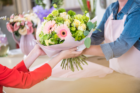 Photo for florist giving beautiful flower bouquet to client - Royalty Free Image
