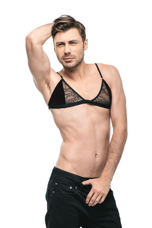young handsome homosexual man posing in womens bra,