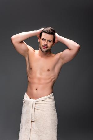 Photo pour man covering with towel after shower - image libre de droit