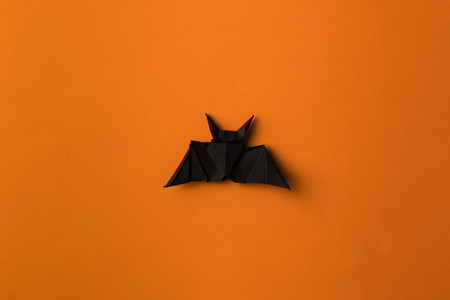 Foto per black halloween origami bat, isolated on orange - Immagine Royalty Free