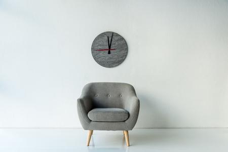 Photo pour Armchair and clock - image libre de droit