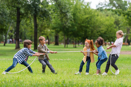 Photo for kids playing tug of war - Royalty Free Image