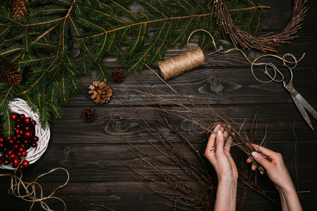 florist making Christmas wreath